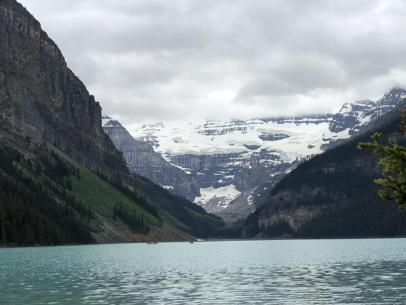 Take a breath seeing the gorgeous Lake Louise. Lake Louise is a hamlet in Banff National Park in the Canadian Rockies, known for its turquoise, glacier-fed lake royalty free stock images