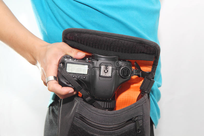 Take camera from the bag stock photos