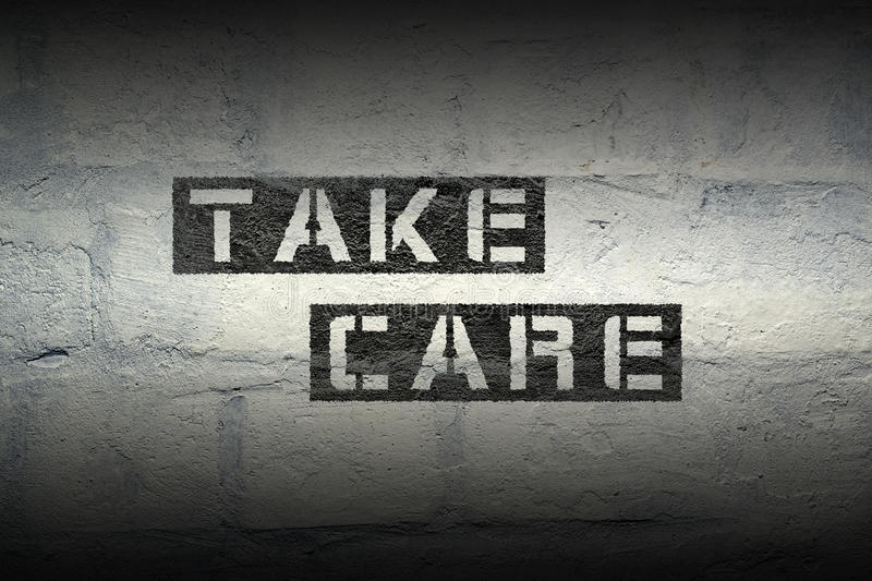 Take care gr. Take care stencil print on the grunge white brick wall royalty free stock image
