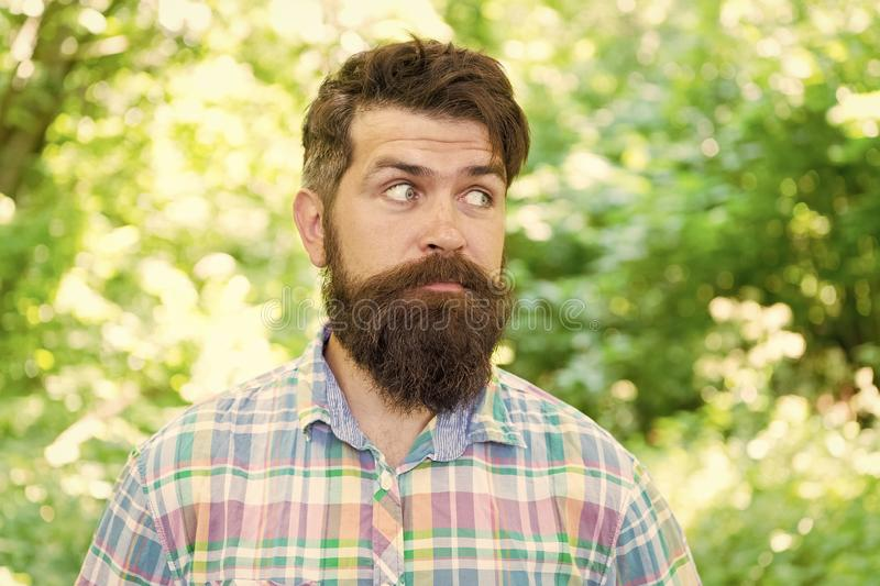 Take care and keep your beard healthy. Surprised hipster taking proper care of moustache and beard hair. Bearded man stock images