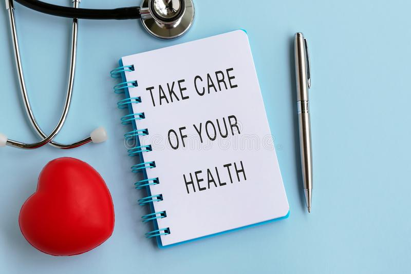 Take care of your health on note pad stock photos