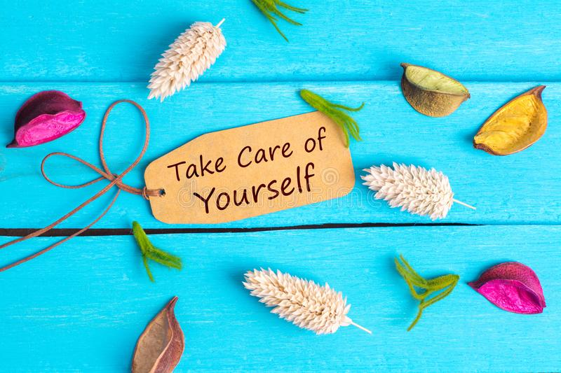 Take care of yourself text on paper tag royalty free stock images