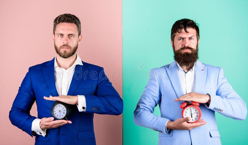 Take control of your habits. Control and discipline. Build your self discipline. Men business formal suits hold alarm royalty free stock images