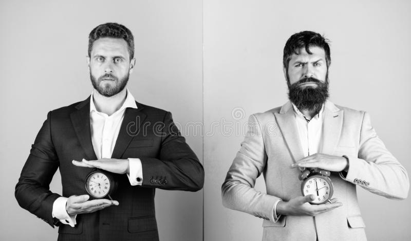 Take control of your habits. Control and discipline. Build your self discipline. Men business formal suits hold alarm stock image