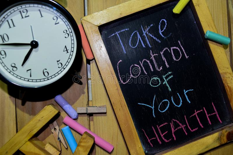 Take Control of your health on phrase colorful handwritten on chalkboard stock photography