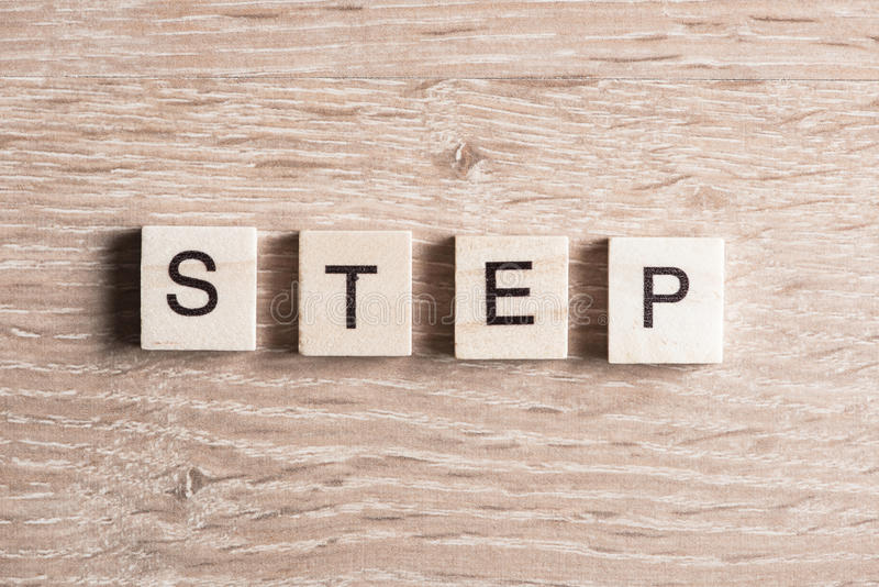 Take decision and make step. Motivation concept collected of wooden elements with the letters royalty free stock photos