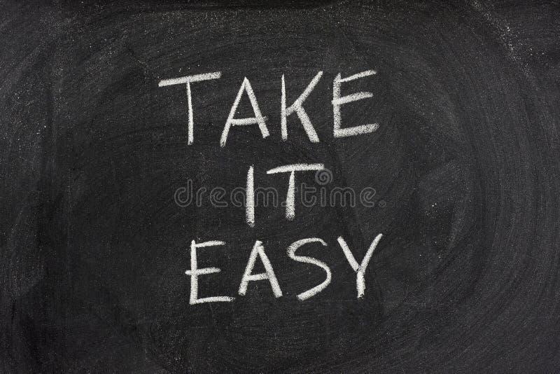 Take It Easy Phrase On Blackboard Stock Photo