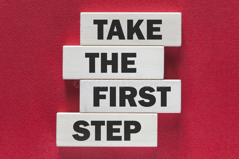 Take the first step. Motivational message royalty free stock image
