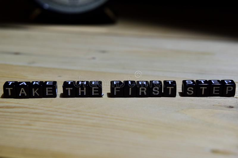 Take the first step written on wooden blocks. Education and business concept royalty free stock photography