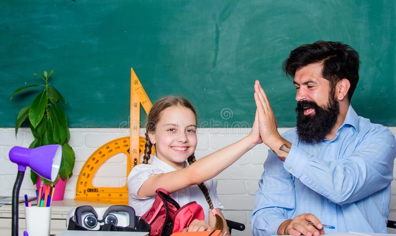 Take five. back to school. Private teaching. private lesson. knowledge day. Home schooling. daughter study with father. Teachers day. small girl child with royalty free stock images