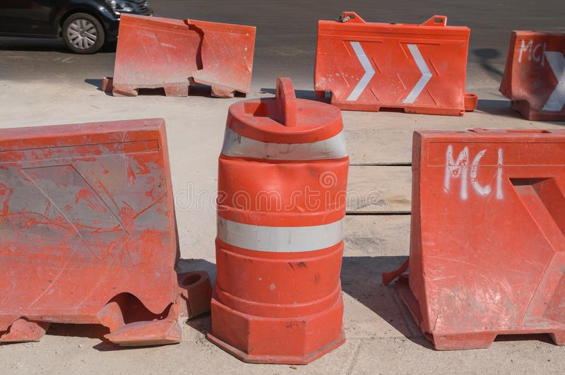 Plastic structures in orange color used as safety barriers during construction work. stock photos