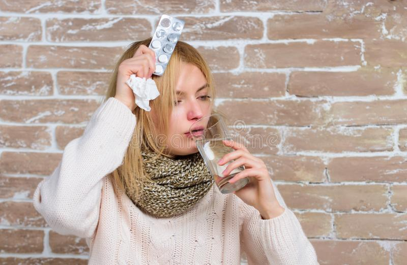 Take medications to reduce fever. What to know about breaking fever. Woman tousled hair scarf hold glass water and. Tablets blister. Girl suffer fever and take stock photos