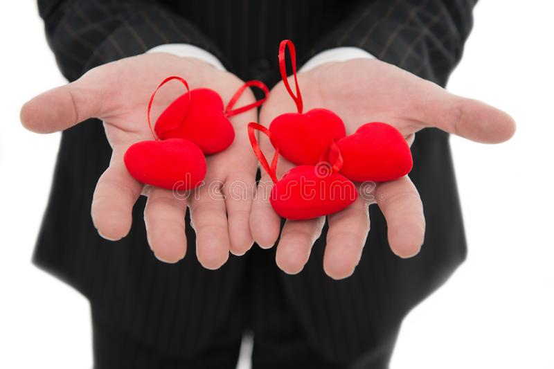 Take my love. Hands holding red hearts. Male open palms with love symbol close up. Love and valentines day concept royalty free stock images