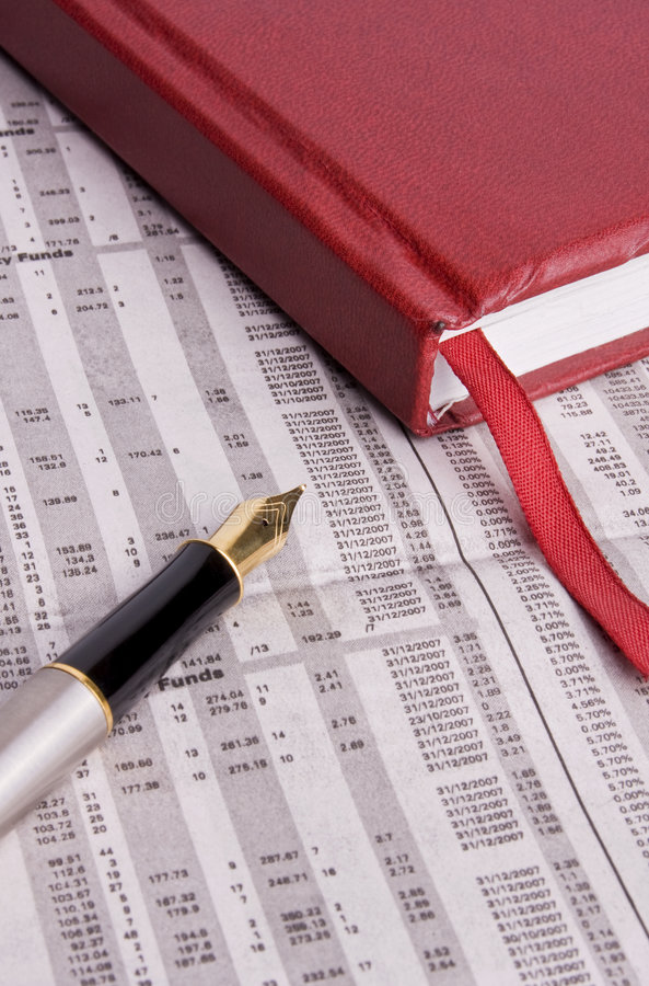 Take note of your investments. A diary and a fountain pen placed on a financial newspaper. Perfect for use in financial scenarios or business topics stock images