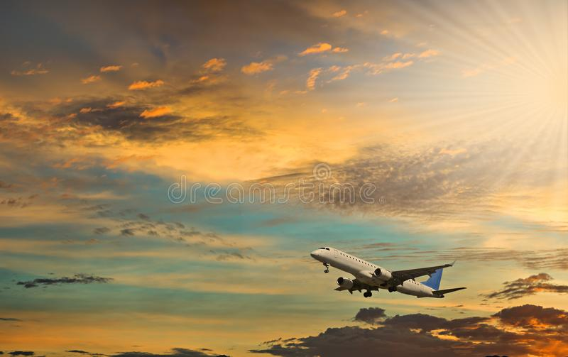 Take off. Airplane at dawn. Sunshine with beams stock photo
