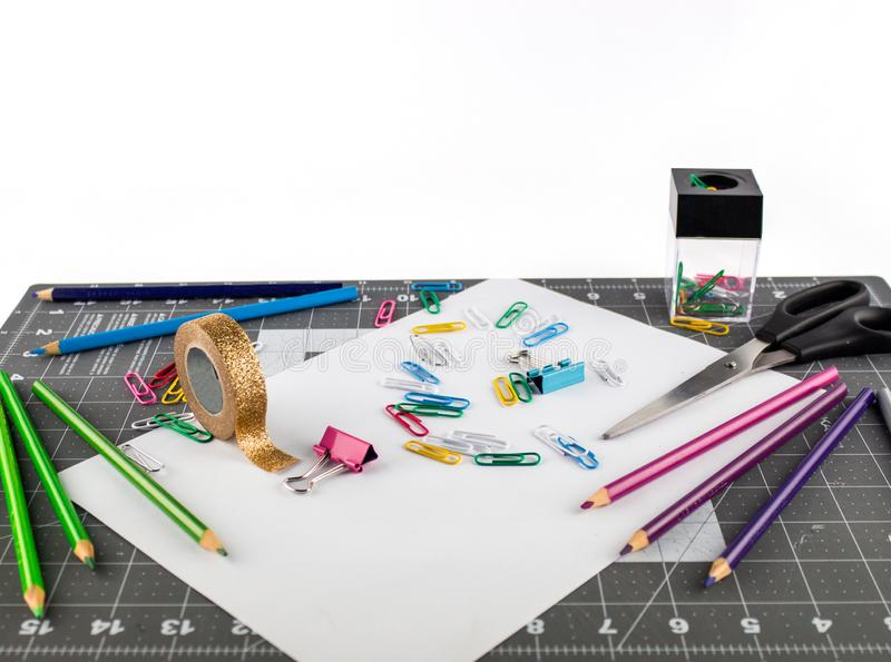 Take office or school supplies on a gridded surface royalty free stock photos