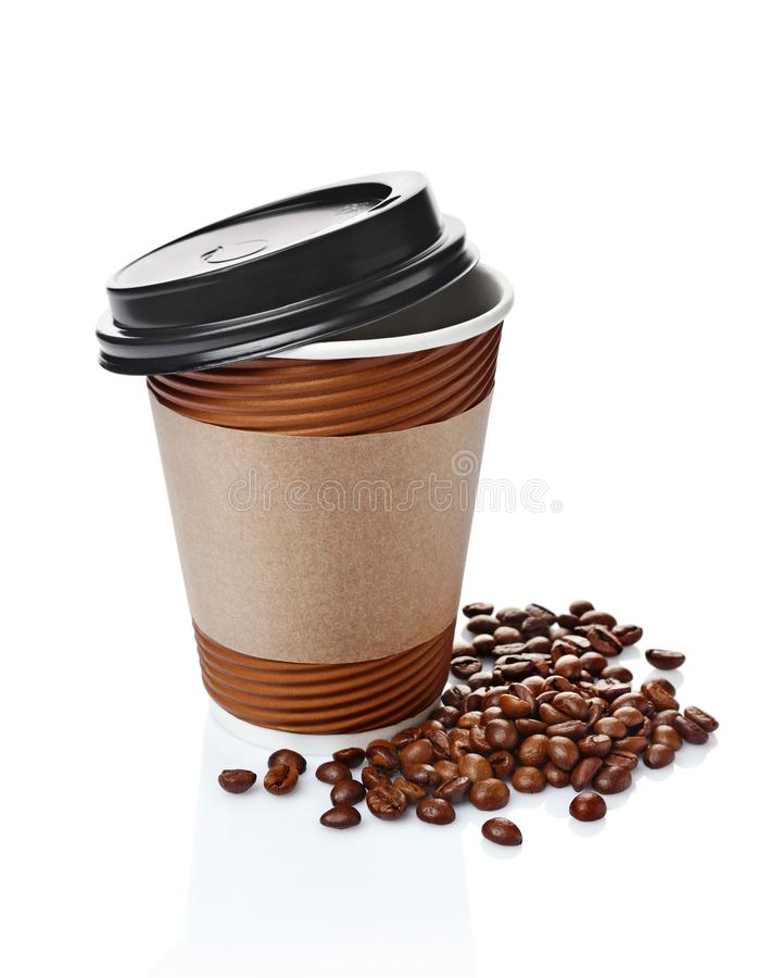 Take-out blank paper brown coffee cup with black cover, craft cup holder and beans. Isolated on white background royalty free stock photos
