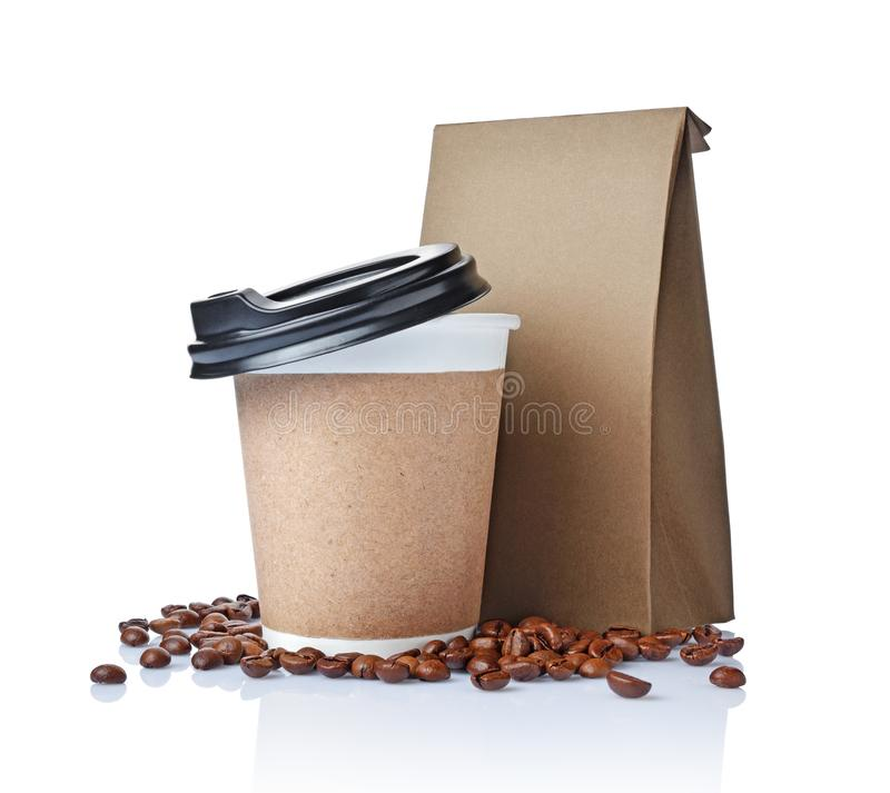 Take-out blank paper coffee cup with black cover, craft cup holder, beans and brown packet. Isolated on white background royalty free stock image