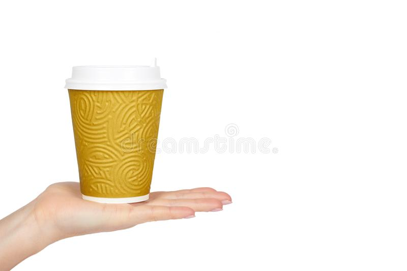 Take out coffee in thermo cup with hand. Isolated on a white background. Disposable container, hot beverage. copy space, template royalty free stock image