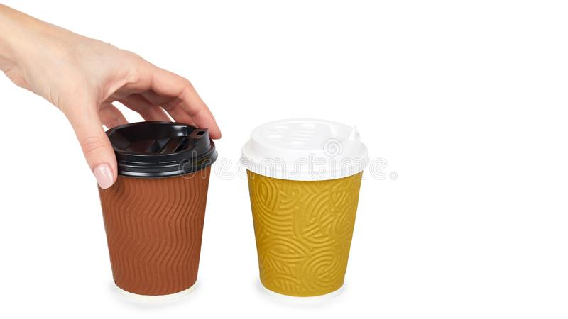 Take out coffee in thermo cup with hand. Isolated on a white background. Disposable container, hot beverage. copy space, template royalty free stock photos