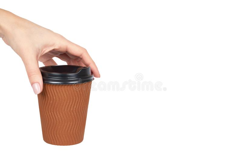 Take out coffee in thermo cup with hand. Isolated on a white background. Disposable container, hot beverage. copy space, template stock photo