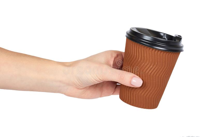 Take out coffee in thermo cup with hand. Isolated on a white background. Disposable container, hot beverage royalty free stock photos