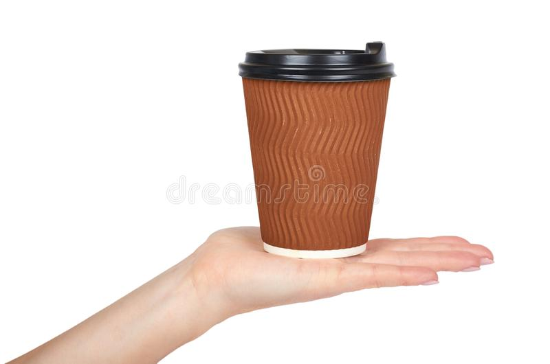 Take out coffee in thermo cup with hand. Isolated on a white background. Disposable container, hot beverage stock photography