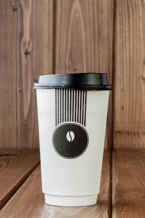 Take-out coffee in thermo cup on a wooden background, Copy space stock photos