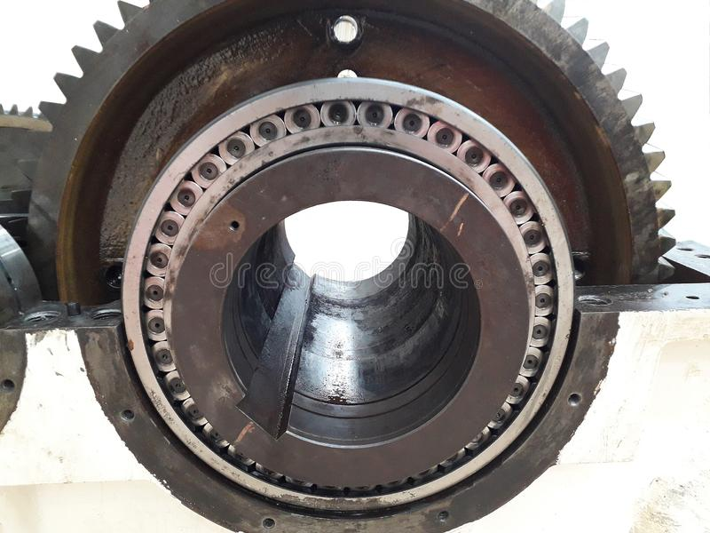 Take out part of machine to repair. And clean the dirty trace of oil stain on shaft gear  bearings stock photo