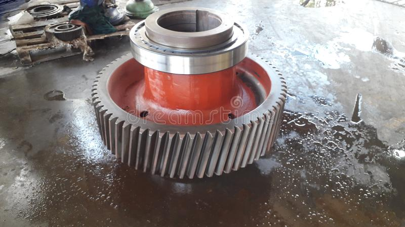 Take out part of machine to repair. And clean the dirty trace of oil stain on shaft gear  bearings stock image