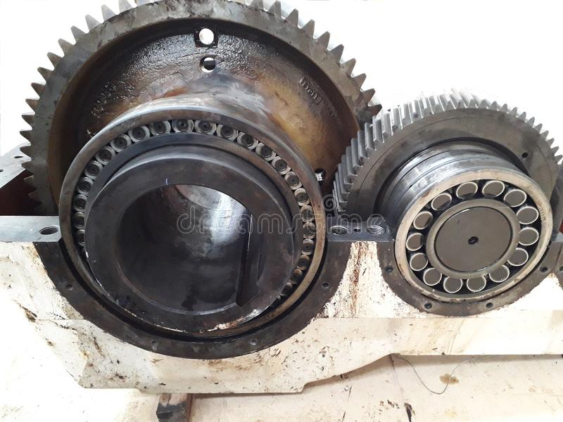 Take out part of machine to repair. And clean the dirty trace of oil stain on shaft gear  bearings stock images