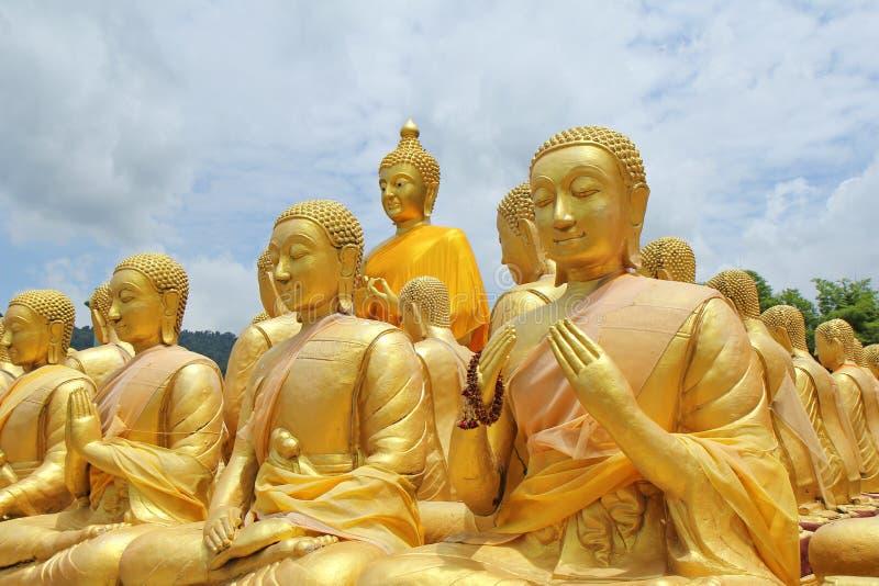 Take photo of  Buddha statue sitting   image of 1250 monks chant around the Buddha image at  Phuttha Utthayan Makha Bucha Anusorn royalty free stock image