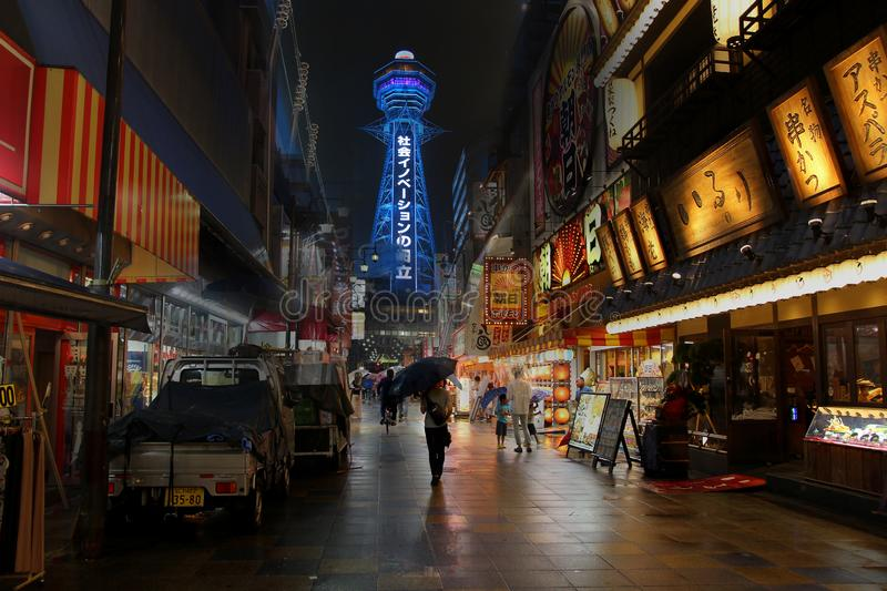 Take photo colorfully street life ,food store and many souvenir shops on the roadside to Tsutenkaku Tower,Osaka, Japan. Osaka,Japan,  13 July 2019, Take photo royalty free stock photos