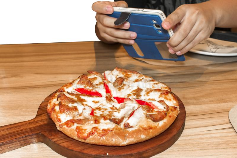 Take a photo by phone before eat pizza. Closed up stock images