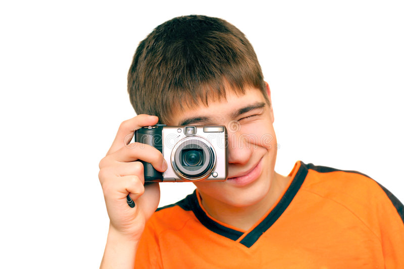 Take a picture. A young teenager gets ready to take a photograph stock photos