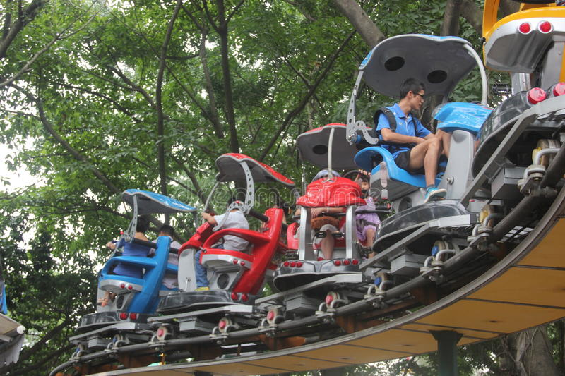 Take the recreation facilities of the tourists in amusement park in the SHENZHEN Zhongshan Park. Tourists ride track recreation facilities to visit the SHENZHEN stock images