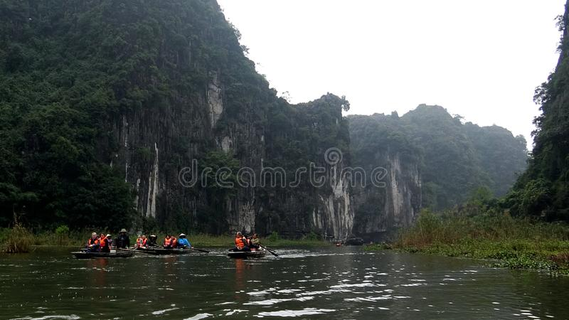 Take a small boat on the river. To visit this place, tourists must travel by boat, down the poetic river, clear water to the bottom to discover the nature of stock photos