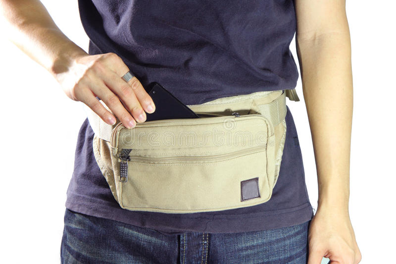 take smart phone from waist belt bag royalty free stock photo
