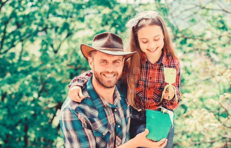 Take you flower. little girl and happy man dad. earth day. new life. family farm. agriculture. spring village country stock images