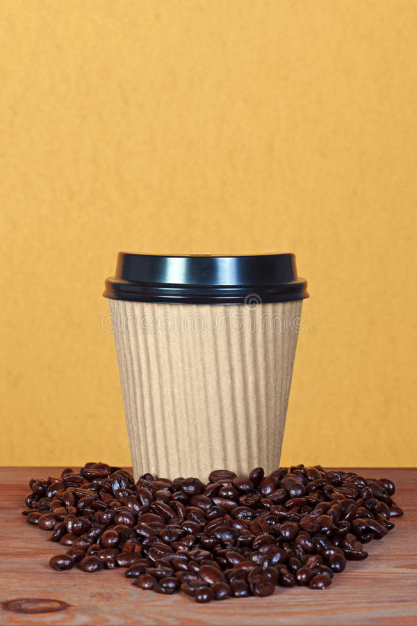 Takeaway Paper Coffee Cup With Beans Royalty Free Stock Photo