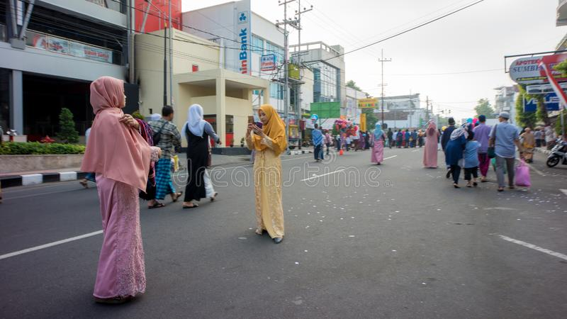 Takeing photos after the Eid prayer in the alun-alun city of Blitar, Indonesia. BLITAR, EAST JAVA / INDONESIA - June 05 2019 : takeing photos after the Eid stock photos