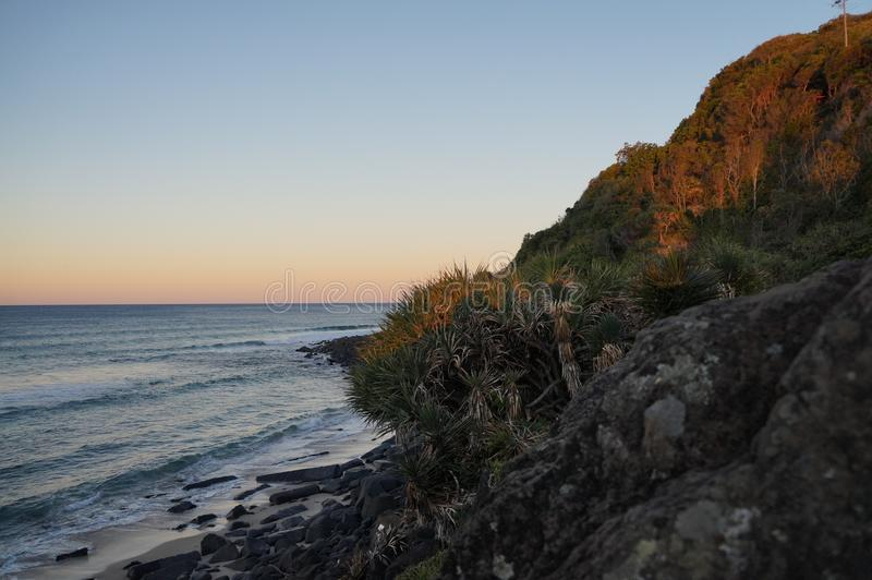 Beaut Burleigh Heads. Taken in the afternoon as the sun was setting. Aspect is `hugging` the mountain to feel the closeness to nature and the headland at royalty free stock images