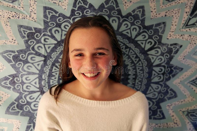 Portrait of a young teenage girl smiling royalty free stock photography