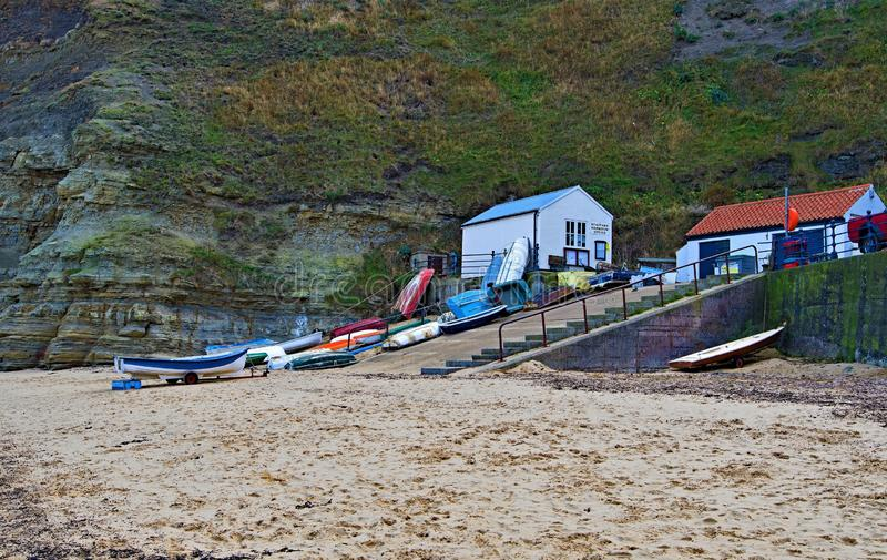 Inland view of Staithes beach and Penny Nab, near Scarborough, in North Yorkshire. royalty free stock photo
