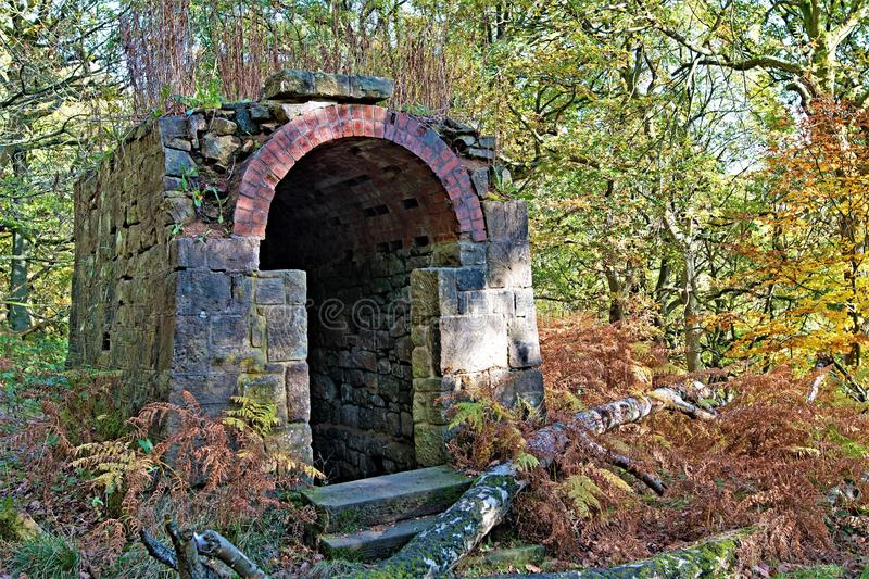 Mysterious outbuilding, in Padley Gorge Woods, Grindleford, East Midlands. Taken to capture the rich autumnal colours and almost camouflaged mysterious stock photo