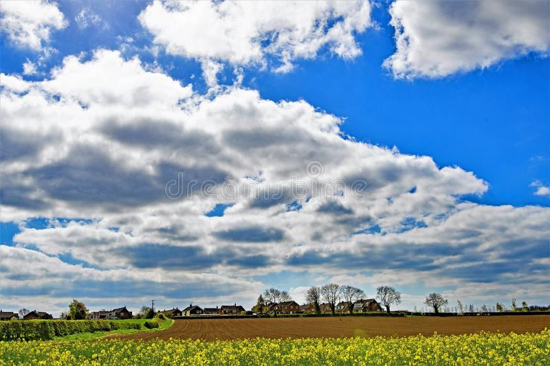 Cloudburst above Sprotbrough farmland, Doncaster. Taken to capture the rich colourations, above and beside a recently ploughed field, in Sprotbrough, Doncaster stock photo