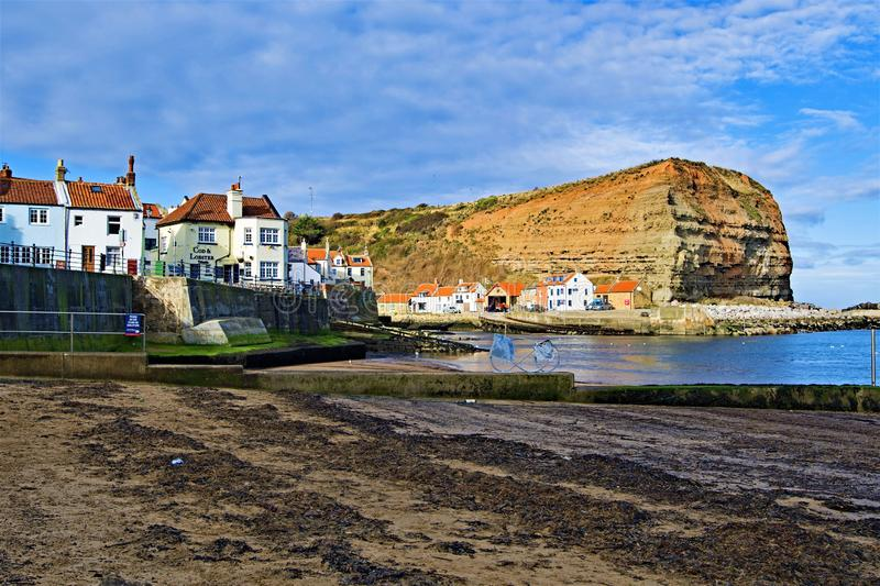 View of the Cod and Lobster and Penny Nab, from staithes Beach, near Scarborough, in North Yorkshire. royalty free stock image