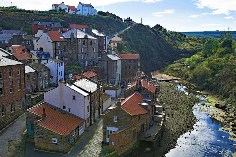 Inland view of Staithes village and river, near Scarborough, in North Yorkshire. stock image