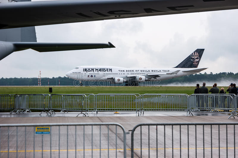 Takeoff Iron Maiden's Boeing 747 Ed Force One. BERLIN, GERMANY - JUNE 01, 2016: Takeoff Iron Maiden's Boeing 747 Ed Force One. The world tour The Book of Souls stock photos