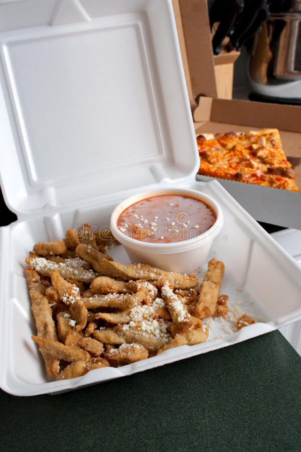 Takeout Food. Italian fast food in takeout containers. Pizza and fried battered eggplant strips stock photo